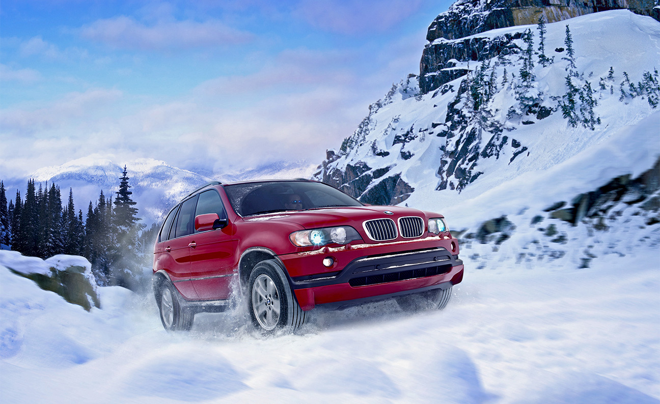 BMW X5 Snow Covered Mountain Road